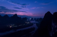 Li River Dawn (Rod Waddington) Tags: china chinese guangxi li river karst mountains hills water dawn moon clouds mist lights landscape sunrise