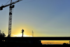Axis (Robin Shepperson) Tags: summer industrial silhouette blue yellow red berlin germany d3400 nikon crane highrise bridge wires cables sun sky clouds light evening twilight