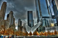 rebirth (kaimonster) Tags: skyscraper architecture city urban manhattan groundzero building tree sky glass steel window newyork transit autumn park york nikon