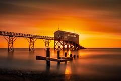Selsey sunrise II (Anthony White) Tags: selseylifeboatstation selsey england unitedkingdom gb sunrise abandoned orange sky vibrant lifeboat rescue seascape goldcollection