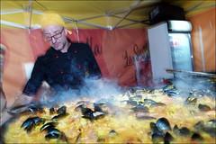 (Sea of Food) (Robbie McIntosh) Tags: leicam9p leica m9p rangefinder streetphotography 35mm leicam autaut candid strangers leicaelmarit28mmf28iii elmarit28mmf28iii elmarit 28mm man woman flash shutterdrag draggingtheshutter colors streetincolor napoli naples food streetfood paella mussels rice internationalbeerfest