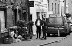 Tudor Rose Florist (Bury Gardener) Tags: suffolk streetphotography street streetcandids snaps strangers candid candids people peoplewatching folks 2018 nikond7200 nikon burystedmunds england eastanglia bw blackandwhite hatterst