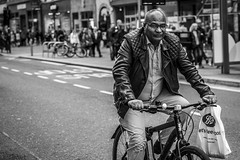 Let's Feel Good (Leanne Boulton (Away)) Tags: bike road people urban street candid portrait portraiture streetphotography candidstreetphotography candidportrait streetportrait eyecontact candideyecontact streetlife man male face eyes expression mood feeling exercise cycling bicycle riding travel transport leather jacket tone texture detail depthoffield bokeh naturallight outdoor light shade city scene human life living humanity society culture lifestyle canon canon5dmkiii 70mm ef2470mmf28liiusm black white blackwhite bw mono blackandwhite monochrome glasgow scotland uk