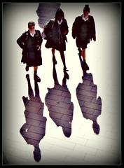 Three little maids from school (ronramstew) Tags: girls schoolgirsls shadows walking liverpool merseyside uk
