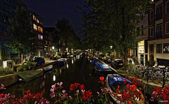 Amsterdam. (alamsterdam) Tags: boats amsterdam canal bloemgracht flowers bridge houses architecture cars bikes evening