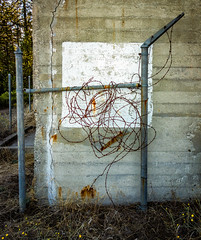Mystery Fence (channel locks) Tags: rx100 fence berkeley bunker barbedwire rust decay concrete