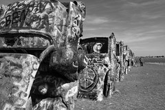 Cadillac Ranch (shutterglide) Tags: sculpture bw painted art cars abstract cadillac ranch bizarre halfburied nosedown