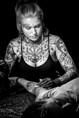 The Tattooist (david.travis) Tags: arm environmentalportrait woman tattoo portraitphotography lowkey portrait