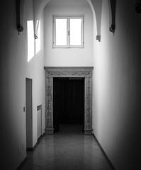The Door (Chiaro Chiari) Tags: porta door blackwhite bn bw monocromo inside finestra window light luce aisle hallway corridoio glow