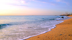 With the first rays (Fnikos) Tags: sea water mar mare wave seascape landscape sand beach shore seashore coast waterfront sky skyline cloud sunrise rock boat outdoor