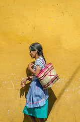 woman by the yellow wall (Pejasar) Tags: woman antigua guatemala yellow wall basket street