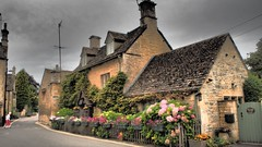 A Chocolate Box House in a Chocolate Box Village. (ManOfYorkshire) Tags: garden gardening flowers flowerboxes bourtononthewater gloucestershire cotswold cotswolds stone yellow picturesque ideal england gb uk village parish preserved