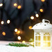 Christmas composition with a lantern, snow on the background of a garland