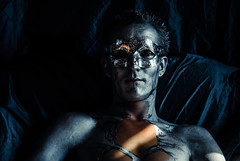 Silver and gold (uomomare) Tags: silver man naked art nude artistic artisticnudes portrait dark noir pose body slim gold glow reflection