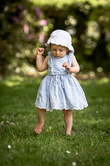 First steps (solomiya.p) Tags: steps girl baby summer green bokeh flowers dress little kid children portrait outdoor hat grass park garden light nature natural canon tiny toes beauty blue pretty