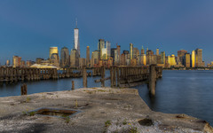 Oyster City (Decaseconds) Tags: hdr newyork city skyline water reflection pier dock concrete wood abandoned night building one world trade center