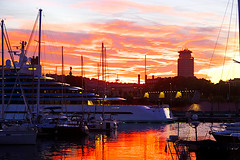 Barcelona sunsets (Fnikos) Tags: port porto puerto harbour harbor sunset sun city architecture tower sea water waterfront sky cloud red dark light skyline boat sailboat ship tree nature sculpture statue outdoor