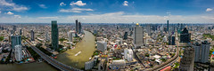 Aerial view of Bangkok skyline and skyscraper with BTS skytrain Bangkok downtown. Panorama of Sathorn and Silom business district Bangkok Thailand with blue sky and clouds. (MongkolChuewong) Tags: aerial aerialview architecture asia bangkok bank blue bridge bts building business capital chaophrayariver city cityscape condominium day district downtown drone droneview high hotel light metropolis modern office reflection residence river sathorn shadow silom skyline skyscrapers skytrain sunrise sunset taksin thai thailand top tower town travel urban vertical view water waterfront krungthepmahanakhon th