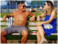 Enjoying the other's Company (HereInVancouver) Tags: candid lifeonaparkbench couple summer laughing enjoyment vancouverswestend canong3x vancouver bc canada englishbaypark shirtless sunglasses urban city smiles