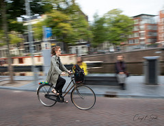 Double Takes   (in Explore) (cheryl strahl) Tags: europe netherlands holland amsterdam prinsengrachtcanal bicyclist bike speed motion tracking morning panning canal