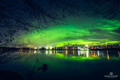 Auroras over the night sky (Gasolin3) Tags: aurora canon 600d 1018 stm efs ef lake reflection finland green trees silhouette composition magical beautiful long exposure contrast explosive amazing city branches colourful wonderful sky night dark