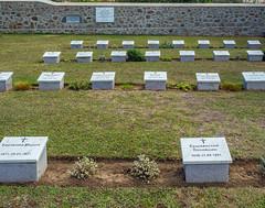 Russian Graves fronm the Evacuation of Novorossisk  - East Moudros War Cemetery - Limnos (Greece) (Olympus OM-D EM1-II &  M.Zuiko 12-40mm f2.8 Pro Zoom) (1 of 1) (markdbaynham) Tags: greece greek limnos lemnos eastmoudros moudros militarycemetery cemetery grecia greka greekholiday gr memorial historic northaegean northaegeanisland olympus omd olympusomd olympusgreece olympusem1 olympusmft mft m43 1240mm f28 em1 em1mk2 em1mark2 em1mkii olyem1 mirrorless csc evil travel ww1 dardenelles graveyard microfourthird microfourthirds micro43 mzd zd mz mzuiko zuikolic m43rd warmemorial military