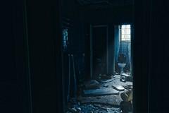 The dark toilet (Acoufreine) Tags: wc urbex toilet toilette hotel abandonné sinistre dark sombre light water débris casse