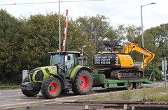Claas 650 Arion Tractor . (AndrewHA's) Tags: cambridgeshire ely railway station level crossing claas 650 arion tractor jcb excavator