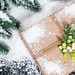 Beautiful decorated gift on snow background. The concept of preparing for the Christmas holidays