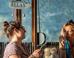 Candid ( Bar Conversation - Sunset Cafe-Bar) (Myrina Town- Limnos - Greece) (Olympus OM-D EM1-II & M.Zuiko 40-150mm f2.8 Pro Telephoto Zoom) (1 of 1) (markdbaynham) Tags: greece greek grecia greka limnos lemnos em1 hellas hellenic myrina mypina myrinatown olympus omd olympusomd olympusgreece olympusmft olympusem1 em1mk2 em1ii em1mark2 csc evil m43 micro43 microfourthird microfourthirds mft mzd mz zd mzuiko zuikolic 40150mm olympusprolens prozoom telephoto m43rd travel micro43rd town northaegean northaegeanisland aegeanisland candid conversation people cafebar sunsetcafe