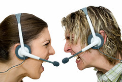 Call Centre Wars (the UMF) Tags: 20s 2025years backgrounds blondehair brownhair female image indoors isolatedonwhite longhair plainbackground sideview twoobjects twopeople whitebackground women youngwomen adult anger business callcentre caucasian color communication concept frustration headset horizontal humanhead isolated male men people screaming shouting studioshot telecommunication white youngadult youngmen