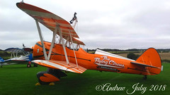 Aerosuperbatics Boeing Stearman #1 (First Choice 360 Mediaworks) Tags: orange airplabe aircraft boeing stearman aerosuperbatics plane grass sky cockpit