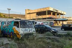 Graffiti rock (Maciej Dusiciel) Tags: architecture architectural city urban street building greece glyfada athens travel europe world sony alpha abandoned urbex car graffiti