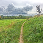 Threatening autumn clouds over the field thumbnail