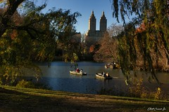 Central Park, New York (Elliott Cowand) Tags: boat lake rowboat centralpark newyork manhattan allrightsreserved copyright canon eos canon1855mm elliottcowandyahoocom elliottcowand autumn fall canon60d buildings highrise water trees optoutgroups