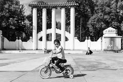 Black & White Street Photography (Frederik Trovatten) Tags: blackandwhite blackandwhitephotography black noir monochrome monochromatic streetphotography street photograper x100f fujifilm fuji girl bike biking