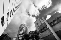 Wrocław Manhattan (PiotrTrojanowski) Tags: wroclaw breslau architecture city housing estate skyscraper blackwhie bw monochrome building clouds sky poland concrete