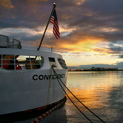 U.S. Coast Guard Cutter Confidence at sunset. (Jill Bazeley) Tags: coast guard station port canaveral cutter confidence moored tied rope flag us military homeland security space brevard county sony a6300 zeiss 1670mm stars stripes sunset american patriotic ensign stern sea boat water sky patriotism inspirational united states fourth july
