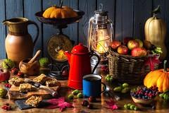 Autumn's Bounty (memoryweaver) Tags: coffee coffeepot mug enamel flapjacks indoor tabletop lamplight lantern paraffin kerosene lamp hurricanelantern hurricanelamp jug berries hawthawn sloes hedgerow pumpkins autumn albanelfed obod druidry paganism wicca mahon stilllife memoryweaver