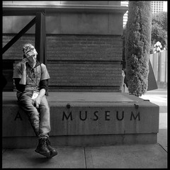 Man on Phone at Museum 18093107 (jimhairphoto) Tags: portlandartmuseum america théâtrederue documentary photography remainsoftheday naturalworld rolleiflex tlr 35automat k4a manufacturedin1953 twinlens rollei 120 film 120film ilford hp5 blackandwhite blancetnoir schwarzeweiss blancoynegro blancinegre siyahrebeyaz jimhairphoto