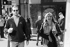Mixed emotions on Borough High Street, London.... (markwilkins64) Tags: streetphotography street candid markwilkins mark london boroughhighstreet southwark uk blackandwhite mono monochrome bw sunglasses scarf smile emotions drinks straws urban couple two
