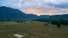 Sunrise first light at Kong Lor Village Khammouane Laos. This is best landmark for tourism  in Laos of Asia. (Sutipond Somnam) Tags: konglo cave laos khammouane morning drone fly asian silhouette fields rice goldenhour cloudssky mountain aerialview view landscape sunrise landmarks asia village travel background beautiful beauty blue clouds countryside europe field forest grass green hiking hill meadow natural nature outdoor panorama rock scenery scenic sky summer tourism tree valley