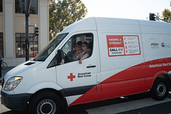 Liz Dietz driving Red Cross ERV during the parade (American Red Cross of Silicon Valley) Tags: veteransdayparade siliconvalleychapter americanredcross sanjose oleksiinazaruk