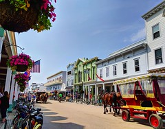 perfect summer day (ekelly80) Tags: michigan mackinacisland august2018 summer upnorth puremichigan street road mainstreet flowers colors bright summerday horses carriage bikes bicycles americanflag