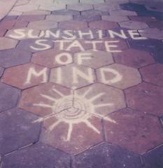 "Sunshine State (dreamscapesxx) Tags: instant polaroid ""polaroidoriginals"" ""polaroidslr680"" ""polaroidoriginals600film"" sidewalk chalk writing sun stpetersburgfl snapitseeit polavoid"