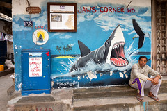 Oblivious (loddeur) Tags: tanzania street jaws shark sidewalk funny art graffiti people