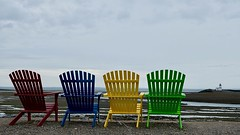 Sea view (halifaxlight (back in Nov)) Tags: canada novascotia parrsboro fundyshore lighthouse adirondackchairs chairs seats shore lowtide sea cloudy overcast summer colourful viewingpoint