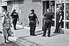 JUST KEEP WALKING . . . (panache2620) Tags: monochrome blackandwhite bw photojournalism photodocumentary socialdocumentary security rentacop street streetscene urban city eos canon candid group