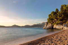 Beach at Sveti Stefan (Augustas Kemežys) Tags: svetistefan opštinabudva juodkalnija me montenegro црна гора crna gora water beach sea landscape nature sky coast shore outdoors sunset sand tree outdoor noperson bodyofwater travel sitting front seashore body view scenery headland rocky sun horizon umbrella adriatic