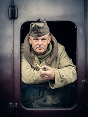 The Yanks are coming! (david.travis) Tags: environmentalportrait male clothing war window train portraitphotography smoking uniform portrait